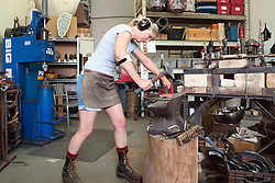 Blacksmith artist Susan Madacsi demonstrates a metal forging technique in her studio. Susan's shared studio with April VanDeGrift and Erin Cunningham was one of the venues on Jodi Eichelberger's ST(r)EAM Artist Studio/Gallery bike tour in the Surel Mitchell Live-Work-Create District in Garden City, Idaho on June 18, 2016.<br /> <br /> Tour started at the studios of Susan Madacsi, April VanDeGrift, Erin Cunningham, and continued to Ken McCall Studios, James &amp; Matt Wilson of Red Valley Mandolins, Arin Arthur, Angie Bowling Sebolt, Belinda Isley, Matt Herberg, Lisa Roggenbuck and the Visual Arts Collective.