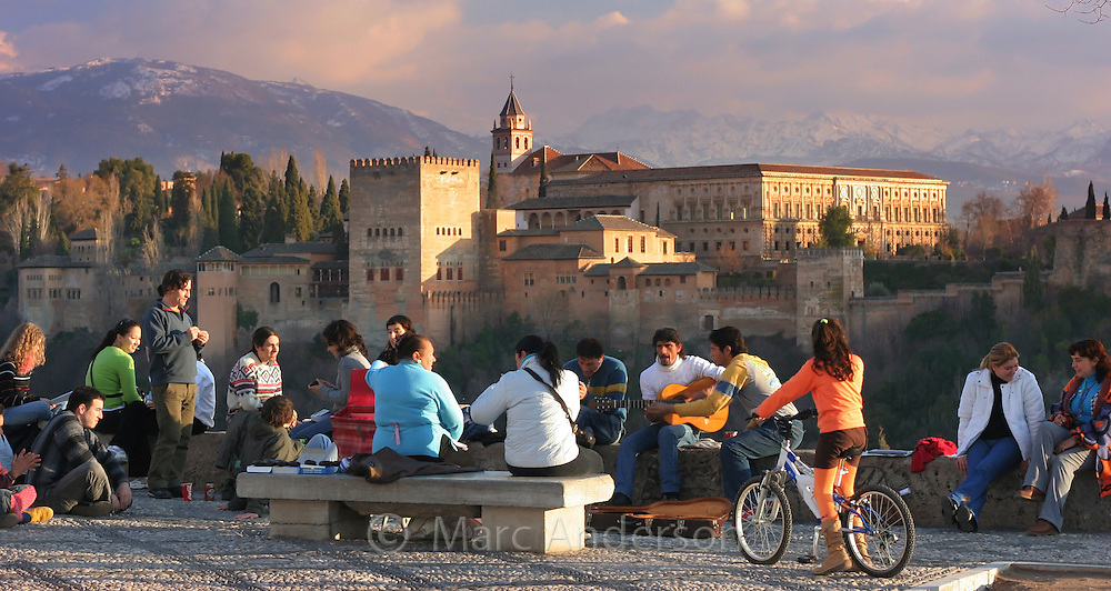 Flamenco guitarists in the Plaza de San Nicolas, in front of the Alhambra Palace, Granada, Spain.