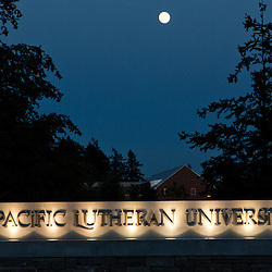 Moonrise over Pacific Lutheran Sign Sept. 28, 2012. (Photo/John Froschauer)