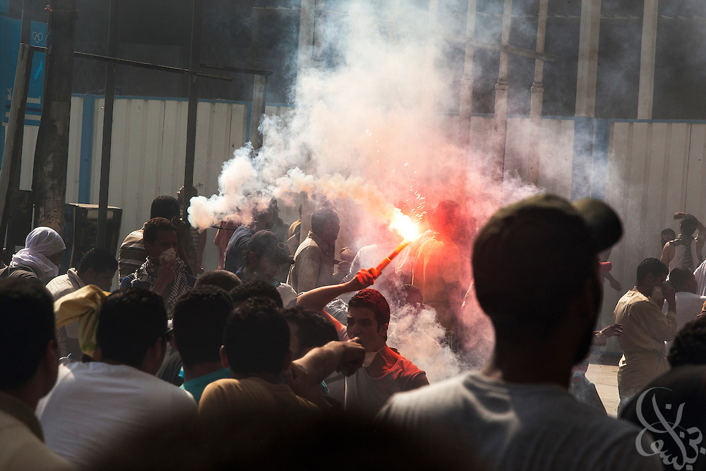 """Supporters of deposed Egyptian President Mohamed Morsi swarm towards the frontline of intense street clashes near Ramsis Square during the August 16, 2014 """"Day of Rage"""" protests in Cairo, Egypt."""