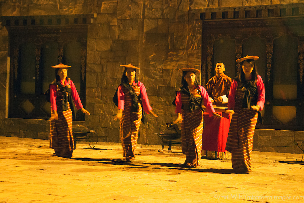 Asia, Bhutan, Thimpu. Traditional Bhutanese dancers at the Taj Tashi Hotel.