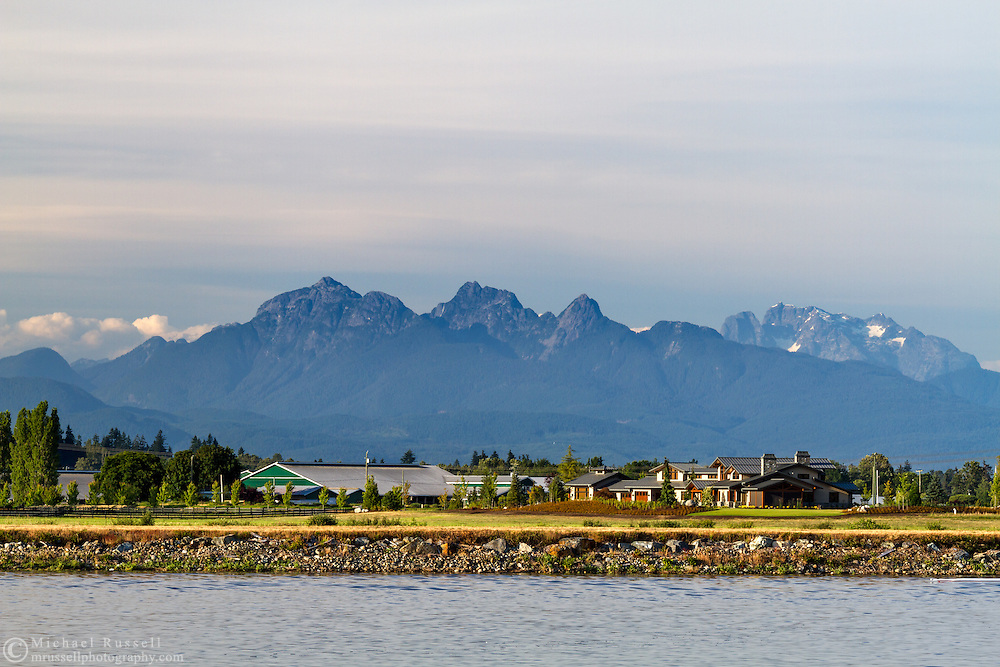 Mount Blandshard (The Golden Ears) and Mount Robbie Reid from the banks of the Nicomeckl River. Photographed from Elgin Heritage Park in Surrey, British Columbia, Canada