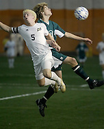 Pine Bush's Mark Quinn, left, and Vestal's Brian Rose leap to head the ball during a Class AA state tournament game at Hudson Valley Sports Dome in Milton on Nov. 8, 2006.