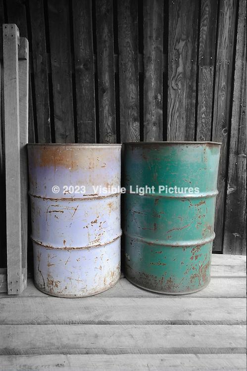 2 colored barrels on a loading dock