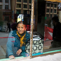 APRIL 5, 2012 : a Tibetan woman waits for a departure at the long distance bus station in Xiahe.