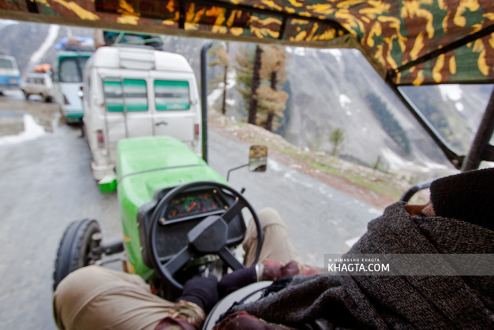 Jaibir Singh Virk taking a quick nap while stuck in a traffic jam on the Srinagar-Leh Highway on Zoji La Pass...In May 2012, Fox Adventure Club set a record for the Longest Tractor Expedition, when three members covered 3623 kms across the western Himalayas in just 14 days on a 65hp Farm Tractor.