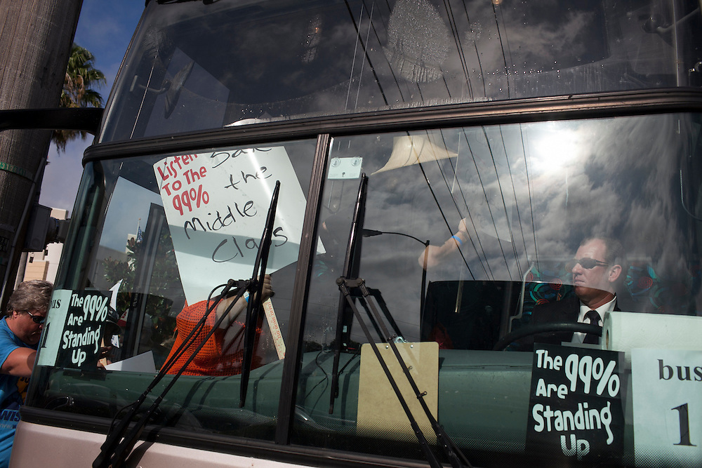 After a protest, protesters board a bus outside of the DoubleTree Hotel, where John Boehner was scheduled to appear, at day 2 of the RNC in Tampa, FL, on Tuesday, Aug. 28, 2012...Photograph by Andrew Hinderaker for TIME.