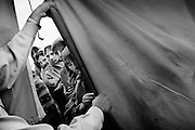 The Pakistan Islamic Medical Association&rsquo;s camp by the river in Muzzafarabad. While the well-organised camps of the international relief organisations quickly filled up and had to turn away the injured, PIMA&rsquo;s went on growing into a noisy, dirty chaos.<br /> Muzzafrabad - Nov/Dec. 2005