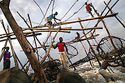 Fishermen check their bamboo nets at Wagenia Falls (or Boyoma Falls), near Kisangani, DR Congo. The nets are checked twice a day, in the early morning and late afternoon.