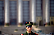Members of the paramilitary police stand guard at a security checkpoint on Beijing's Tiananmen Square March 10, 2009. Security in the area around the square has been increased in an effort to prevent any protests during the annual meeting of China's National People's Congress and the 50th anniversary of the uprising in Tibet.