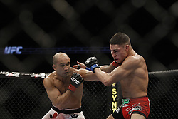 Dec 12, 2009; Memphis, TN, USA; UFC Lightweight Champion BJ Penn and challenger Diego Sanchez during their bout at UFC 107 at the FedEx Forum in Memphis, TN.  Penn retained his title when the bout was stopped on cuts in the 5th round.