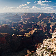 Moran Point, South Rim of Grand Canyon National Park, Arizona, USA. Grand Canyon began forming at least 5 to 17 million years ago and now exposes a geologic wonder, a column of well-defined rock layers dating back nearly two billion years at the base. While the Colorado Plateau was uplifted by tectonic forces, the Colorado River and tributaries carved Grand Canyon over a mile deep (6000 feet / 1800 meters), 277 miles (446 km) long and up to 18 miles (29 km) wide. (Panorama stitched from 5 photos.)
