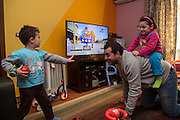 CAIRO, EGYPT - FEBRUARY 25: Al Jazeera English (AJE) producer Baher Mohamed plays with his daughter Fairouz (top) and son Hazem (l) February 25, 2015 at their family apartment in the Sheikh Zayed district on the outskirts of Cairo, Egypt. Baher, and fellow Al Jazeera defendent Mohamed Fahmy were conditionally released on Feb 12, 2015 following Egypt's highest appeal courts decision to grant them a retrial, which has since been postponed until March 8. (Photo by Scott Nelson, for the Washington Post)
