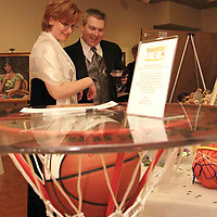 Shelley and Gary Dickstein, from Dayton look at some of the items in the silent auction, including this cafe table with a ball signed by the members of the 2007 men's basketball team at the 2007 Arts Gala at Wright State University, Saturday evening..