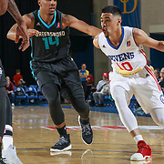 Delaware 87ers Guard MIKH MCKINNEY (10) drives towards the basket as Greensboro Swarm Guard RALSTON TURNER (14) defends in the first half of an NBA D-league regular season game between the Delaware 87ers and the Greensboro Swarm (Charlotte Hornets) Wednesday, March 29, 2017, at The Bob Carpenter Sports Convocation Center in Newark, DEL