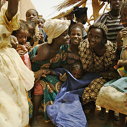 Children play a game called Takliliko where they fall into the arms of others while singing in the  village of Intedeyne March 15, 2007.    the challenge to educate children in Mali still exists and particularly for girls. Female literacy rates never reach even 50 percent of male literacy rates. Mali has the highest percentage of people living below the poverty line in any country in the world. Ninety percent of Malians survive on less than two dollars a day.