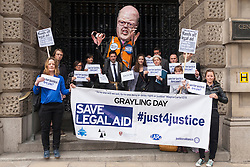 London, June 16th 2014. Lawyers, students and barristers protest outside the Old Bailey against Justice Minister Chris Grayling's cuts to legal aid budgets.