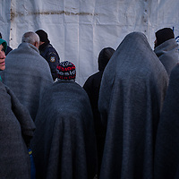 Migrants coverd with blankets wait to try to cross the Greek Macedonian border at the Idonemi makeshift camp, Greece. FEDERICO SCOPPA/CAPTA