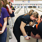 Assistant coach Tom Richardson, right, comforts Karissa Shiflet, 16, after the Lions placed third at regionals, failing to qualify for the state tournament after being the team to beat.