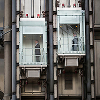 City workers and The Lloyds of London building in the City of London.