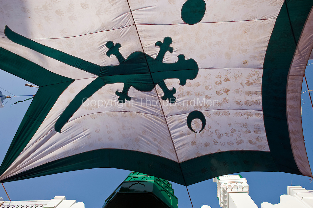 Flag hung for shade over courtyard in Nagore Aandagai Dargah Shareef.