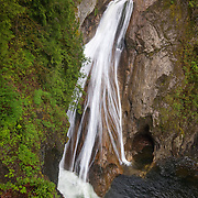 The south fork of the Snoqualmie River drops 135 feet (41 meters) at Lower Twin Falls near North Bend, Washington. The waterfall is located in the Twin Falls Natural Area of Olallie State Park.