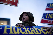 Gerik Smart, age 6 months from Wolfeboro, N.H., is surrounded by campaign signs at a rally for Republican presidential hopeful and former Arkansas governor Mike Huckabee at a polling station in Londonderry, N.H., on Tuesday, Jan. 8, 2008.