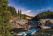 The Pleaides (the Seven Sisters) star cluster, and the stars of late autumn and winter rising over Elbow Falls in Kananaskis Country in Alberta, on a moonlit night, with a waxing gibbous Moon providing the illumination. <br /> <br /> This is a 20-second exposure at f/2.8 with the 24mm lens and Nikon D750 at ISO 1250. A brief wash of LED light painted the foreground water.