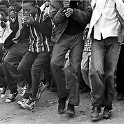 IPLM0035 , South Africa, Venda. VhaVenda men and boys dance and whistle flutes in a dance called the Tshikona that honours King Tshivhase, one of the paramount chiefs of the Venda people.