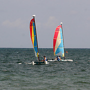 Two Hobie cats sailing in the Caribbean.