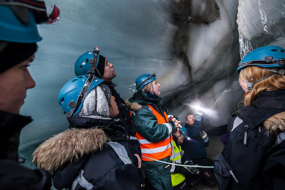 UNIS professor Doug Benn (center) lectures his students inside an ice in Scott Turnerbreen, Svalbard.