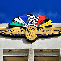 Indianapolis Motor Speedway Logo in Indianapolis, Indiana<br /> This Wing and Wheel was the trademark symbol for the Indianapolis Motor Speedway from the 1970&rsquo;s until 2008. The logo still adorns the entrance of the Racing Hall of Fame. This is a 30,000 square-foot museum that tells the story of the raceway from its troubled start in 1909 until the present. The museum displays over 75 cars. 30 of the autos won the Indy 500.
