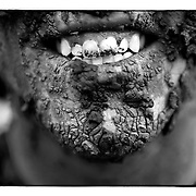 SHOT 6/5/10 2:58:07 PM - Kyle Simonett, 20, of Vail, Co. flashes a mud caked smile after competing in the Teva MXT Mud Run at the Teva Mountain Games in Vail, Co. Competitors ran laps around a course that required them to navigate a mud filled pit. The games attract some of the world's best extreme athletes to compete in kayaking, climbing, mountain bike racing, freeride, big air, trail and road running and dog competitions. (Photo by Marc Piscotty / © 2010)