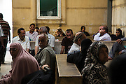 Egyptian patients wait for treatment at the National Liver Institute in downtown Cairo, Egypt June 10, 2015. The Institute began treating Hepatitis C patients with direct-acting antiviral sofosbuvir last year as part of a large scale program that eventually hopes to lower Hepatitis C rates from 15% in Egypt down to just 2% within a decade. (Photo by Scott Nelson, for the New York Times)