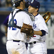 Wilmington Blue Rocks catcher Cam Gallagher (35), LEFT,  hugs Wilmington Blue Rocks relief pitcher Mark Peterson (22), RIGHT, at the conclusion of a MLB minor league regular season victory over the Winston-Salem Dash Monday, April 14. 2014 at Daniel S. Frawley Stadium in Wilmington, DEL.
