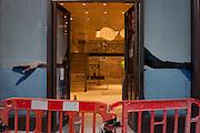 A workman seen through the open doorway of a new Jigsaw shop in central London.