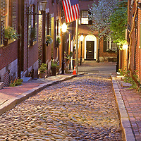Romantic Boston cityscape photography of old colonial brick row houses along Acorn Street on a beautiful spring evening. Spring blossoms are blooming on Acorn Street near Louisburg Square, the most prestigious address in Beacon Hill. Street lanterns provide the warm night light in Beacon Hill. Acorn Street, often mentioned as the most frequently photographed street in the United States of America. It is a narrow lane paved with cobblestones that was home to coachmen employed by families in Mt. Vernon and Chestnut Street mansions.<br /> <br /> This Boston street photography image of historic Acorn Street in Beacon Hill is available as museum quality photography prints, canvas prints, acrylic prints or metal prints. Prints may be framed and matted to the individual liking and wall decoration needs: <br /> <br /> http://juergen-roth.artistwebsites.com/featured/acorn-street-of-beacon-hill-juergen-roth.html<br /> <br /> Good light and happy photo making!<br /> <br /> My best,<br /> <br /> Juergen<br /> http://www.exploringthelight.com<br /> http://www.rothgalleries.com<br /> @NatureFineArt<br /> http://whereintheworldisjuergen.blogspot.com/