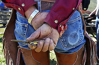 A ranch hand takes a break from cattle branding operations at the Mead Ranch in Spring Gulch near Jackson, Wyoming.