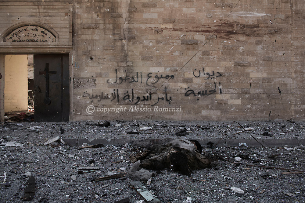 Iraq, Mosul: Dead body of an ISIS fighter in front of Um Al Maonna church in west Mosul. Alessio Romenzi