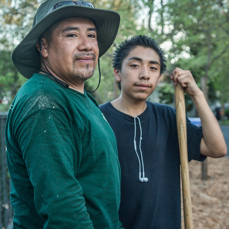 David Palacious with his seventeen year old son, Anthony, do yard work at their home in Calistoga.