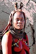 Himba woman, Himba village near Purros, Kaokoland, Kunene Region, Namibia..