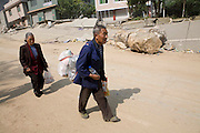 This couple had worked from the stadum holding 10,000 people to return to their wrecked home. They were aware that their home was destroyed but had been provided with a make shift tent as a temporary measure. Mu Guang Ying (82) and her husband (87) had a further 3 hour walk negotiating landslides and boudlers that have swept away the mountain passes.