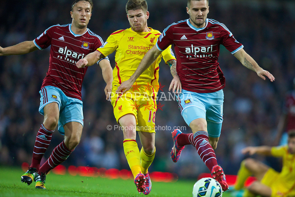 LONDON, ENGLAND - Saturday, September 20, 2014: Liverpool's Alberto Moreno in action against West Ham United during the Premier League match at Upton Park. (Pic by David Rawcliffe/Propaganda)