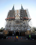HOLD FOR RUSS BYNUM STORY-  Worker stand in front of the Cathedral of St. John the Baptist during major repairs on the church's Gothic architecture, Thursday, March 14, 2013 in Savannah, Ga. Deep cracks where discovered between the bricks that form the towering twin steeples and is expected to cost the Roman Catholic Diocese of Savannah about $1.5 million to fix.  (AP Photo/Stephen Morton)