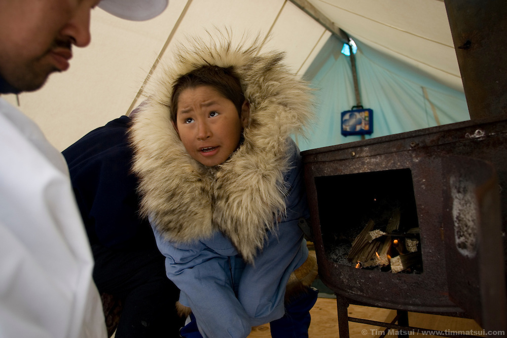 May 3, 2008 -- Kivalina, AK, U.S.A..Nine year-old Justin Cooper Swan at his adoptive father's whaling camp, two miles out on the melting pack ice and 12 miles from the native village of Kivalina, Alaska. Kivalina is suing 20 oil companies for property damage related to global warming; the ocean pack ice forms later and melts earlier, leaving the town vulnerable to erosive winter storms and endangering their traditional subsistence lifestyle. (Photo by Tim Matsui)