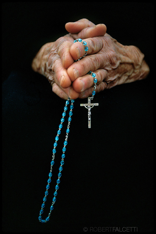 MEDJUGORJE, BOSNIA-HERCEGOVINA: The praying hands of an old woman hold a Catholic Rosary during a Mass at St. James Church in Medjugorje.  (Photo by Robert Falcetti)