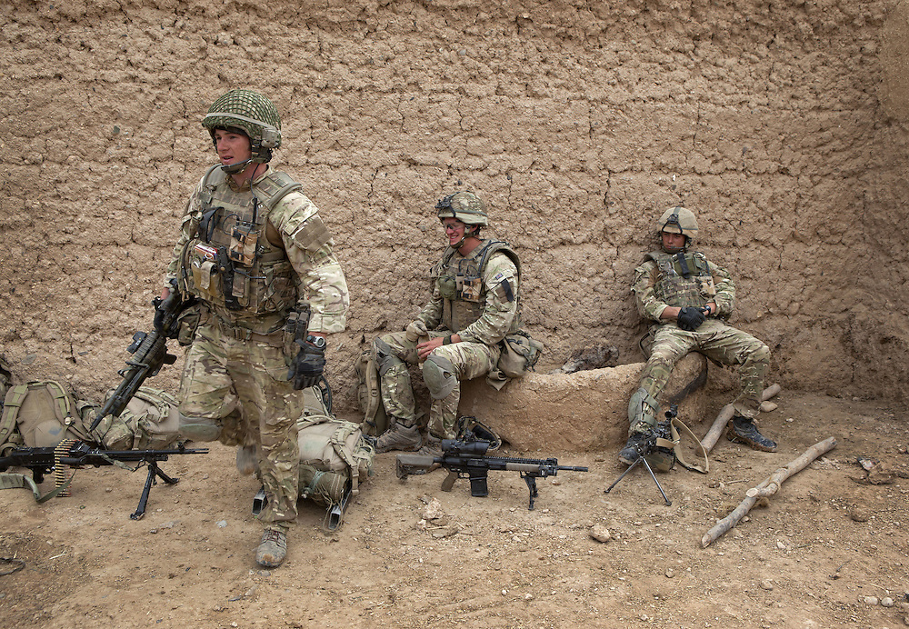 British soldiers of 16 Air Assault Bde's elite BRF (Brigade Reconnaissance Force) take a break after a pre dawn start as they move from compound to compound searching for weapons and explosives as part of an operation in the Western Dasht, Helmand Province, Southern Afghanistan on the 18th of March 2011.
