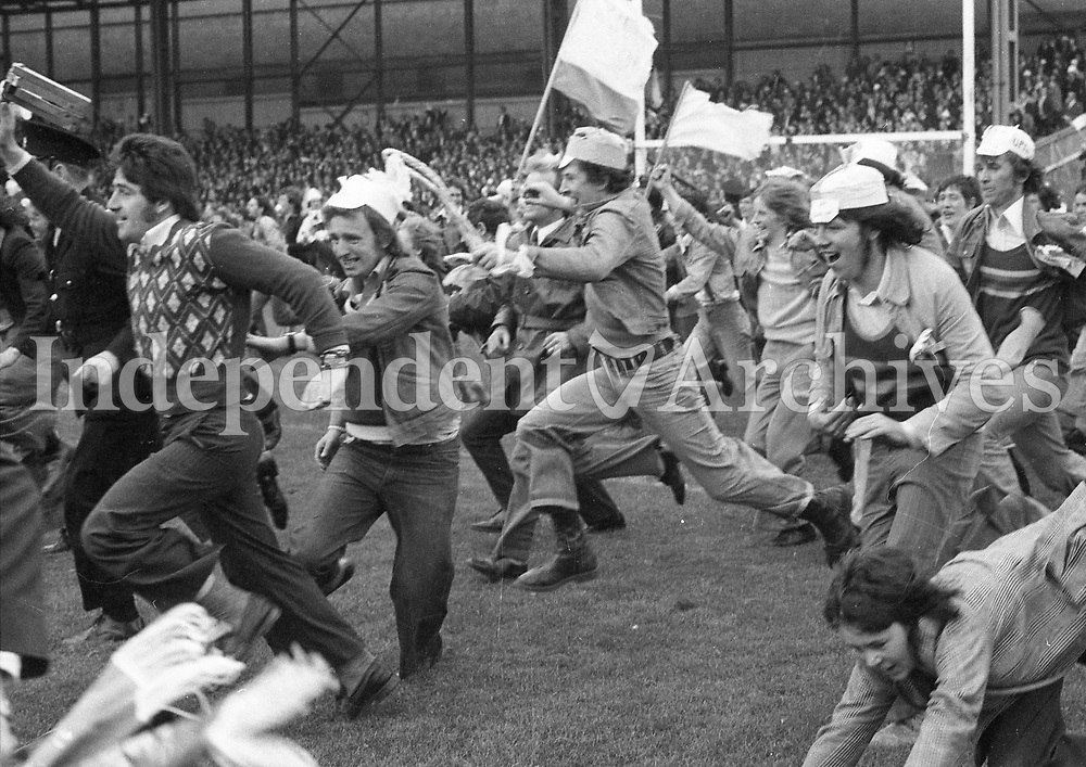 Dublin fans run on to the pitch after they defeated Galway in the All-Ireland Football Final at Croke Park. (Part of the Independent Newspapers Ireland/NLI collection.)