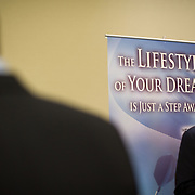 """A coaching service displays a """"The Lifestyle of Your Dreams"""" sign at a job fair at the Rosslyn Holiday Inn in Arlington, VA on Friday, Jan. 15, 2010."""