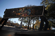 Tim Jones and Marsh Nabors of Pearl River Glass Studio remove the stained glass window from Ventress Hall in Oxford, Miss. on Wednesday, December 1, 2010 so that it may be repaired..